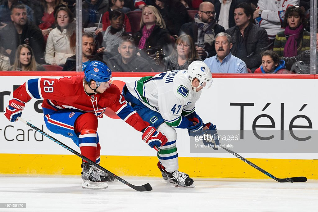 Sven Baertschi #47 of the Vancouver Canucks skates the puck against Nathan Beaulieu #28 of the Montreal Canadiens during the NHL game at the Bell Centre on November 16, 2015 in Montreal, Quebec, Canada. The Montreal Canadiens defeated the Vancouver Canucks 4-3 in overtime.