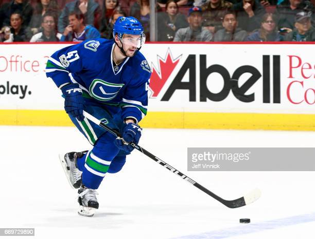 Sven Baertschi of the Vancouver Canucks skates up ice with the puck during their NHL game against the Anaheim Ducks at Rogers Arena March 28 2017 in...
