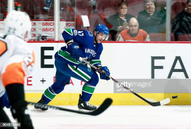 Sven Baertschi of the Vancouver Canucks skates up ice with the puck during their NHL game against the Philadelphia Flyers at Rogers Arena December 7...