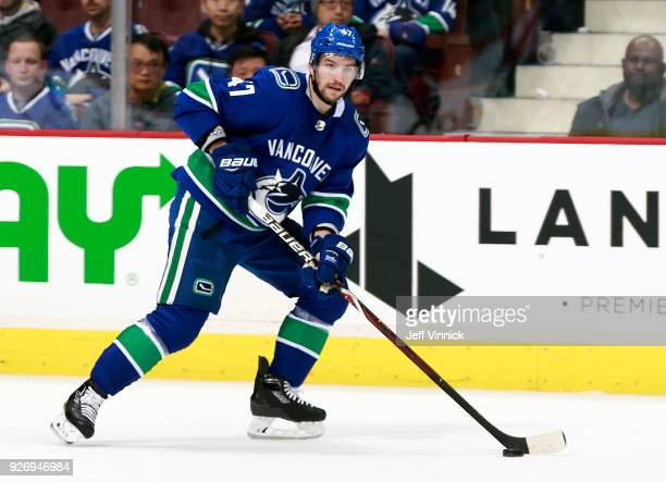 Sven Baertschi of the Vancouver Canucks skates up ice with the puck during their NHL game against the New York Rangers at Rogers Arena February 28...