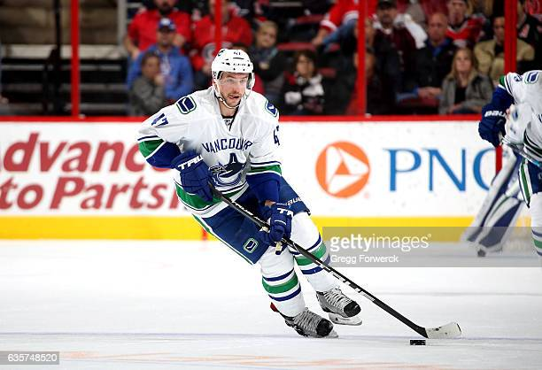 Sven Baertschi of the Vancouver Canucks skates with the puck during an NHL game against the Carolina Hurricanes on December 13 2016 at PNC Arena in...