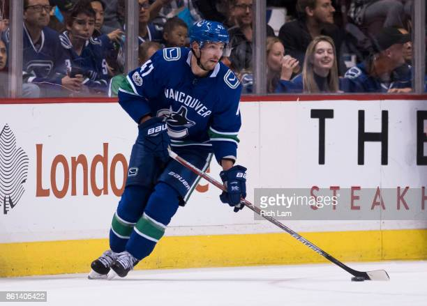 Sven Baertschi of the Vancouver Canucks skates with the puck in NHL action against the Edmonton Oilers on October 7 2017 at Rogers Arena in Vancouver...
