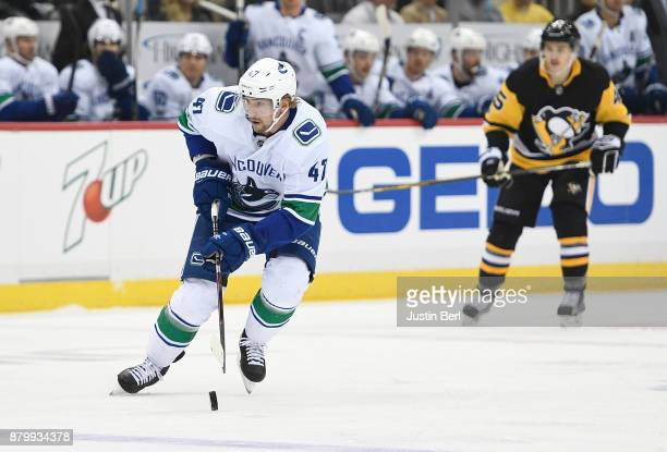 Sven Baertschi of the Vancouver Canucks skates with the puck in the first period during the game against the Pittsburgh Penguins at PPG PAINTS Arena...
