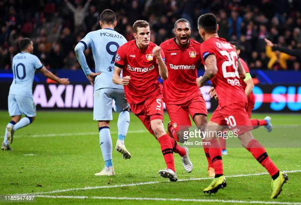Sven Bender Jonathan Tah and Charles Aranguiz of Bayer 04 Leverkusen celebrate their team's first goal which was a Atletico Madrid own goal during...