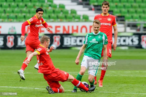 Sven Bender of Bayer 04 Leverkusen and Christian Gross of SV Werder Bremen battle for the ball during the Bundesliga match between SV Werder Bremen...