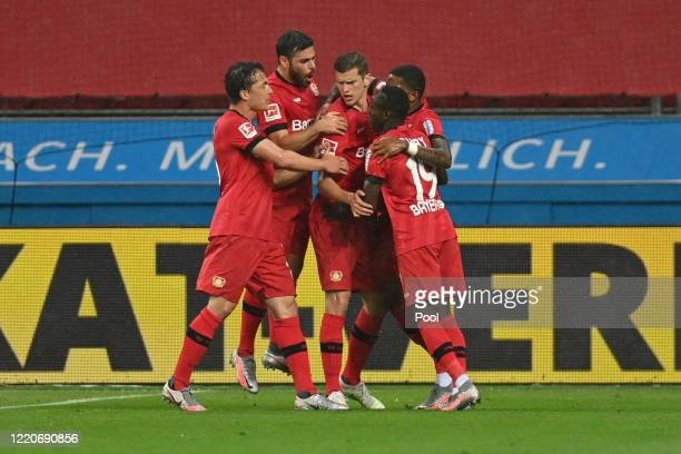 Sven Bender of Bayer 04 Leverkusen celebrates with teammates after scoring his team's first goal during the Bundesliga match between Bayer 04...