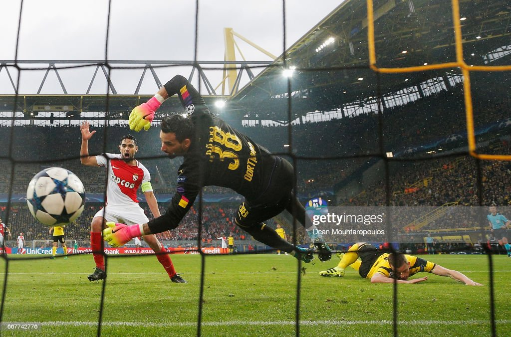 Sven Bender of Borussia Dortmund (R) scores an own goal during the UEFA Champions League Quarter Final first leg match between Borussia Dortmund and AS Monaco at Signal Iduna Park on April 12, 2017 in Dortmund, Germany. The match was rescheduled after an alleged terrorist attack on the Borussia Dortmund team coach as it made it's way to the stadium.