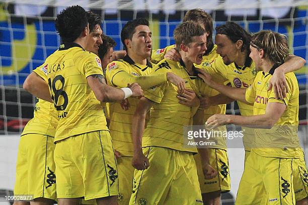 Sven Bender of Dortmund celebrates his team's first goal with team mates during the Bundesliga match between 1 FC Kaiserslautern and Borussia...