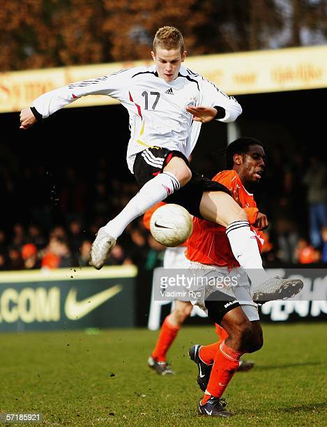 Sven Bender of Germany shoots on goal as Vurnon Anita of Netherlands defends during the Men's Under 17 European Championship qualifier match between...