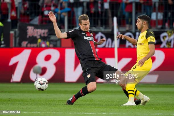 Sven Bender of Leverkusen and Achraf Hakimi of Borussia Dortmund battle for the ball during the Bundesliga match between Bayer 04 Leverkusen and...
