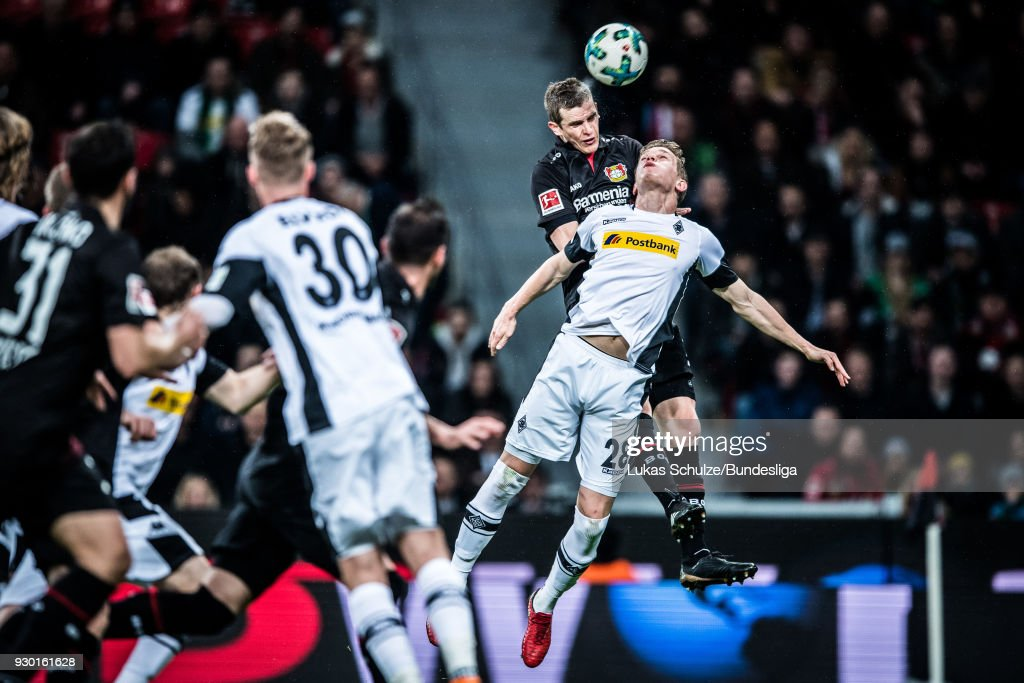 Sven Bender (2R) of Leverkusen and Matthias Ginter (R) of Moenchengladbach head the ball during the Bundesliga match between Bayer 04 Leverkusen and Borussia Moenchengladbach at BayArena on March 10, 2018 in Leverkusen, Germany.