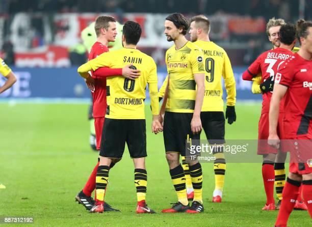 Sven Bender of Leverkusen speaks with Nuri Sahin of Dortmund and Neven Subotic of Dortmund after the Bundesliga match between Bayer 04 Leverkusen and...