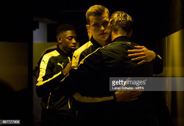 Sven Bender Ousmane Dembele and Lukas Piszczek of Dortmund are focused in the player tunnel prior to the UEFA Champions League Quarter Final first...