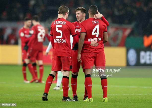 Sven Bender Panagiotis Retsos and Jonathan Tah of Leverkusen celebrate after winning 42 the DFB Cup quarter final match between Bayer Leverkusen and...