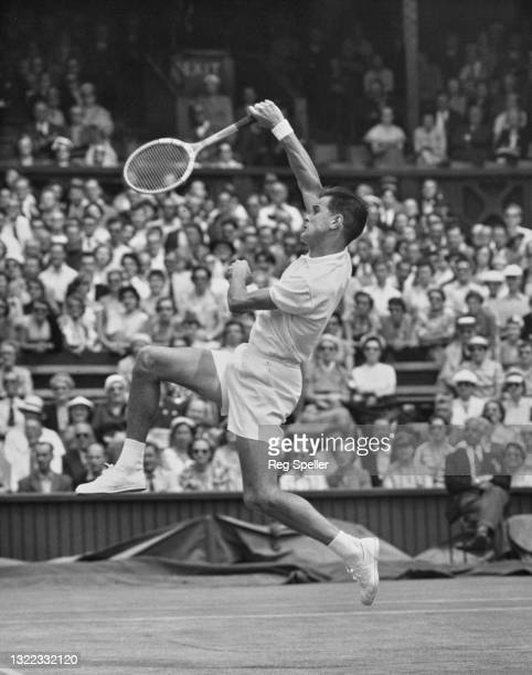 Sven Davidson of Sweden reaches to make an overhead forehand return against Ashley Cooper of Australia during their Men's Singles Second Round match...