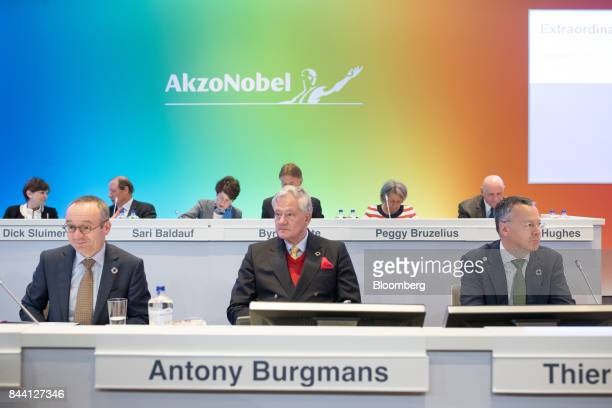 Sven Dumoulin general counsel of Akzo Nobel NV left Antony Burgmans chairman of Akzo Nobel NV center and Thierry Vanlancker chief executive officer...