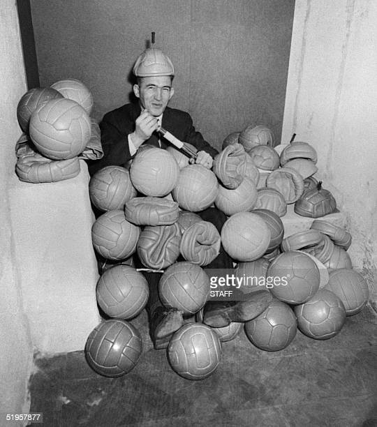 Sven Erik Westerberg from the Swedish Football Federation smiles 08 February 1958 in Stockholm as he pumps one of the 102 soccer balls sent by 102...