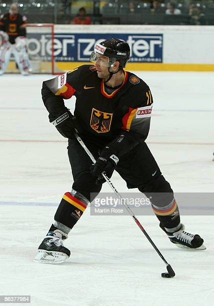 Sven Felski of Germany skates with the puck during the IIHF World Ice Hockey Championship relegation round match between Germany and Denmark at the...