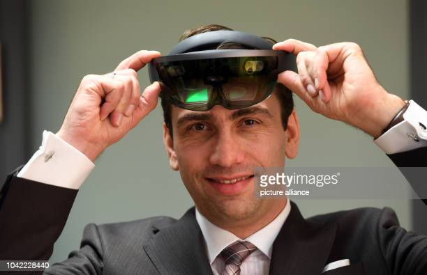 Sven Gabor Janszky holds up virtual reality glasses during an interview with the German PressAgency in Potsdam Germany 16 November 2016 Photo Ralf...