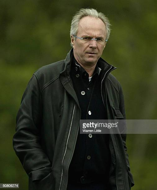 Sven Goran Eriksson England football manager watches his son Johan as he caddies for countryman Johan Edfors of Sweden during the first round of the...