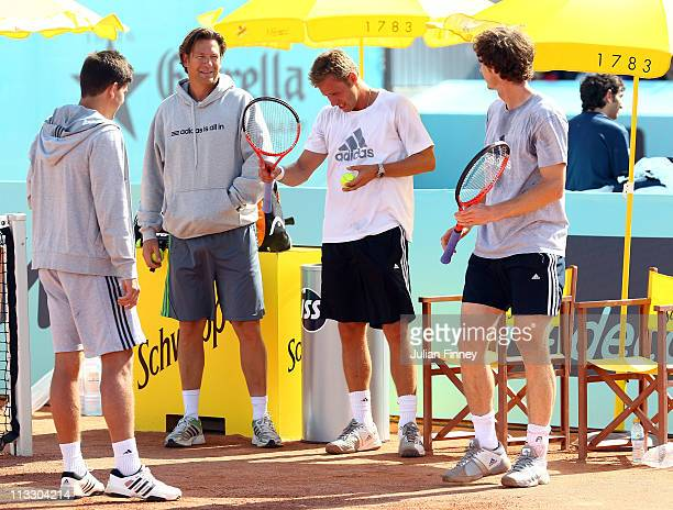 Sven Groeneveld and Mats Merkel of Adidas talk to Andy Murray of Great Britain and Daniel Vallverdu in a practice session during day two of the Mutua...
