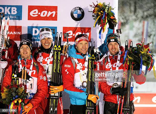 Sven Grossegger Julian Eberhard Simon Eder and Dominik Landertinger of Austria celebrate third place on the podium after the Men's 4x75km relay of...