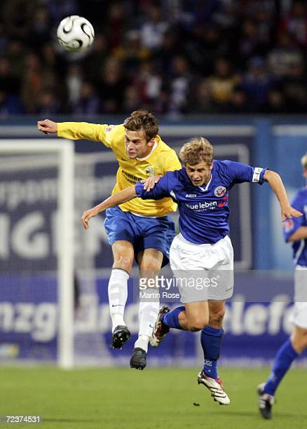 Sven Guenther of Jena and Marc Stein of Rostock jump to head the ball during the Second Bundesliga match between Hansa Rostock and Carl Zeiss Jena at...