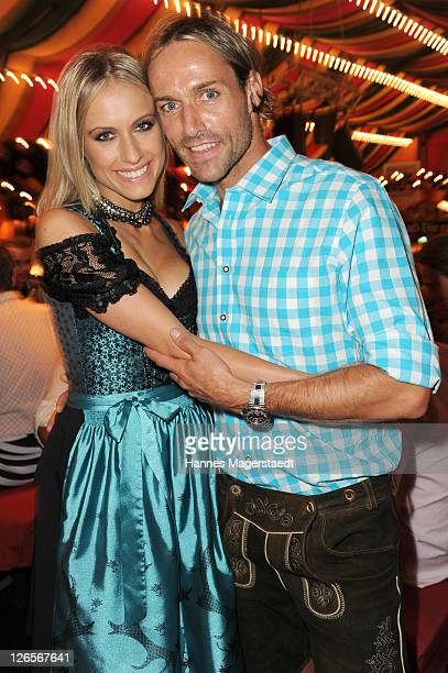 Sven Hannawald and girlfriend Alena Gerber attends the 'Charity Wiesn' as part of the Oktoberfest beer festival at Hippodrom beer tent on September...