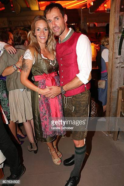 Sven Hannawald and his girlfriend fiance Melissa Thiem during the 'Almauftrieb' as part of the Oktoberfest 2016 at Kaeferschaenke beer tent on...