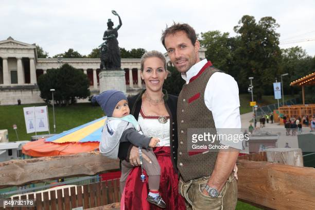 Sven Hannawald and his wife Melissa Hannawald and their son Glen during the 'Alpenherz Wies'n' as part of the Oktoberfest at Theresienwiese on...