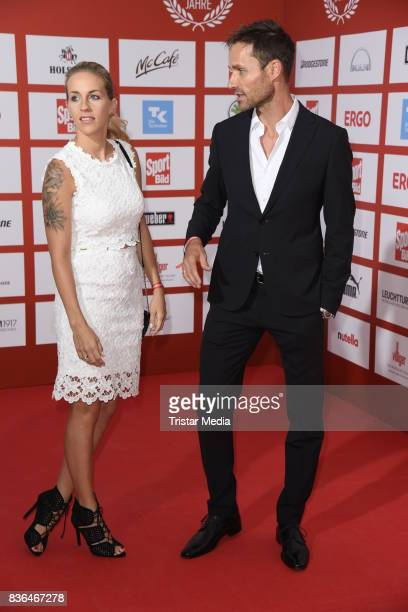 Sven Hannawald and his wife Melissa Hannawald attend the Sport Bild Award on August 21 2017 in Hamburg Germany