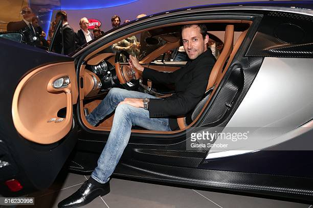 Sven Hannawald in the 'Chiron' car during the Bugatti boutique opening on March 17 2016 in Munich Germany