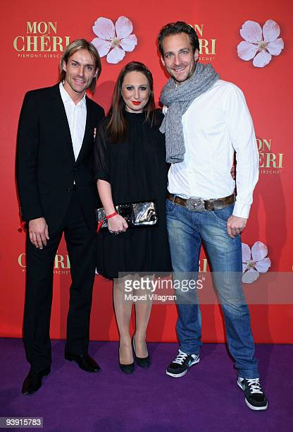 Sven Hannawald Tim Lobinger and girlfriend Alina Baumann attend the 'Barbara Day' on December 4 2009 in Munich Germany