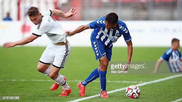 Sven Koehler of Schalke is challenged by Demarveay Sheron of Karlsruhe during the A Juniors Bundesliga Semi Final match between U19 Karlsruher SC and...