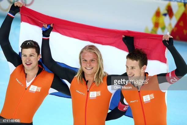 Sven Kramer Koen Verweij and Jan Blokhuijsen of the Netherland celebrate winning the gold medal during the Men's Team Pursuit Final A Speed Skating...