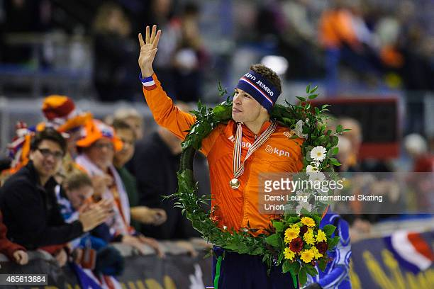 Sven Kramer of Netherlands does a victory lap after placing first overall in the ISU World Allround Speed Skating Championships at Olympic Oval on...