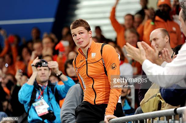 Sven Kramer of Netherlands goes into the crowd to celebrate winning the gold medal in the men's speed skating 5000 m on day 2 of the Vancouver 2010...