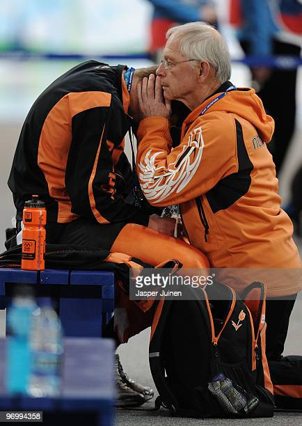 Sven Kramer of Netherlands is comforted by Henk Gemser after being disqualified in the men's speed skating 10000 m on day 12 of the 2010 Vancouver...