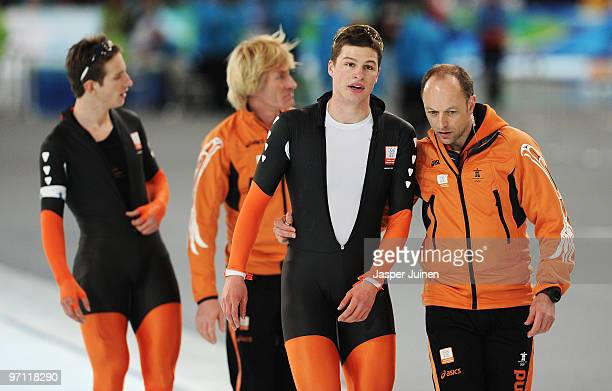 Sven Kramer of team Netherlands is consoled by coach Gerard Kemkers in the Men's Team Pursuit Speed Skating SemiFinals on day 15 of the 2010...