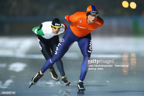 Sven Kramer of the Netherlands and Andrea Giovannini of Italy compete in the 5000m Mens race during the World Allround Speed Skating Championships at...