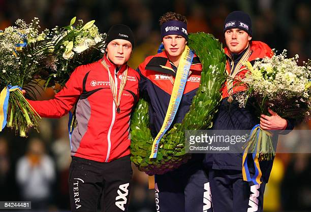 Sven kramer of the Netherlands celebrates winning the European Championships , Havard Bokko of Norway celebrates winning the second place and Wouter...
