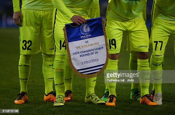 Sven Kums of Gent holds the The KAA Gent v VfL Wolfsburg pennant before the UEFA Champions League match between KAA Gent and VfL Wolfsburg at...