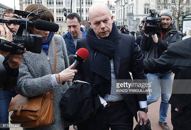 TOPSHOT Sven Mary lawyer of key suspect in the Paris terror attacks Salah Abdeslam arrives to the Council Chamber of Brussels on March 24 2016 during...