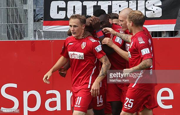 Sven Michel of Cottbus jubilates with team mates after scoring the second goal during the third league match between FC Energie Cottbus and...