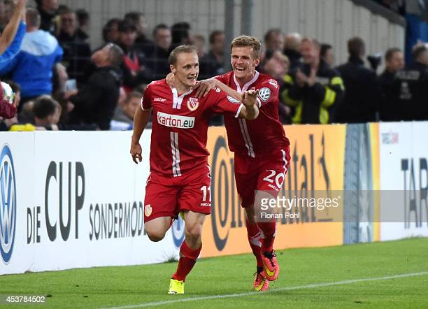 Sven Michel of FC Energie Cottbus and Manuel Zeitz of FC Energie Cottbus celebrate the 2:2 goal during the DFP Cup first round match between Energie...