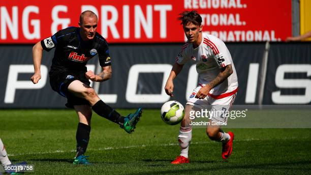 Sven Michel of Paderborn challenges Maximilian Bauer of Unterhaching during the 3 Liga match between SC Paderborn 07 and SpVgg Unterhaching at...