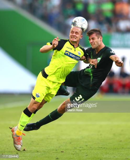 Sven Michel of SC Paderborn 07 and Robin Knoche of VfL Wolfsburg compete for the ball during the Bundesliga match between VfL Wolfsburg and SC...