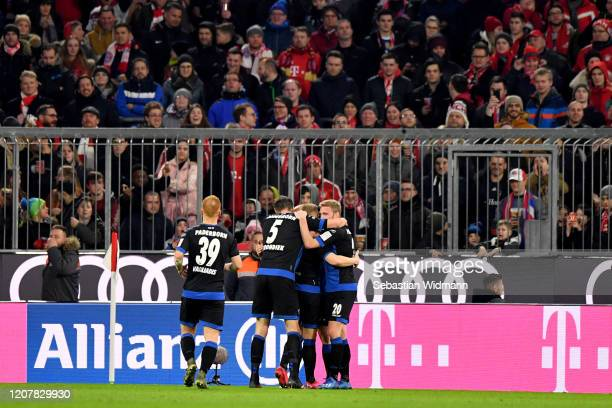 Sven Michel of SC Paderborn celebrates with teammates after scoring his team's second goal during the Bundesliga match between FC Bayern Muenchen and...