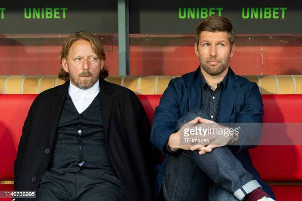 Sven Mislintat of VfB Stuttgart and Thomas Hitzlsperger of VfB Stuttgart look on prior to the Bundesliga playoff second leg match between 1. FC Union...