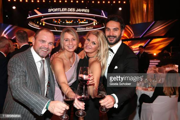 Sven Ottke and his wife Monic Frank and Magdalena Brzeska and her boyfriend Roland Klein during the 'Sportler des Jahres 2019' Gala at Kurhaus...